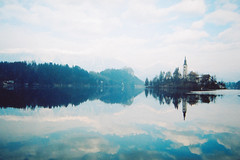 lake bled (impossible soul) Tags: lake reflection film church water clouds minolta slovenia bled analogue cheapfilm explored