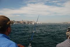Istanbul Fisherman (Let Ideas Compete) Tags: travel bridge turkey fishing fisherman istanbul rod galata takenonabridge galeta touristcity muslimcountry takenfromabridge secularcountry