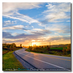 Western New York Highway Sunset (:: Igor Borisenko Photography ::) Tags: road blue autumn trees light sunset orange sun ny green fall colors yellow clouds rural photoshop square golden high fantastic highway colorful warm raw nef state quality country vivid poetic pa powerlines adobe format erie puffy tones balanced allrightsreserved lightroom westernnewyork realistic twolane nothdr cs5 nikond80 igorborisenkophotography