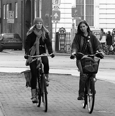 BEAUTIES ON BIKES (Akbar Simonse) Tags: street girls people urban bw holland netherlands beauty zwartwit candid streetphotography denhaag bicycles babes thehague trafficsigns streetshot dedoka 200000000stagelovers akbarsimonse