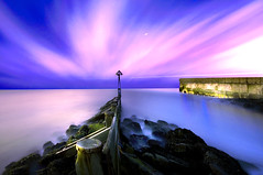 The Rush and the Calm (dan barron photography - landscape work) Tags: wood longexposure light night dark pier magenta blues northumberland hues rush posts seatonsluice cloudtrails nikond90