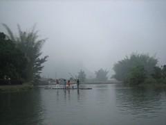 Crossing the river.. (MelindaChan ^..^) Tags: china travel water misty fog river tour guilin yangshuo chinese tourist bamboo mel raft melinda sampan 桂林 陽朔 chanmelmel melindachan