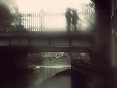 Little Venice - Warwick avenue bridge.. (Che-burashka) Tags: bridge woman man west london love water monochrome rain umbrella vintage canal couple romance retro regentscanal gettys emotions s3 littlevenice warwickavenue katianosenko gettyskn