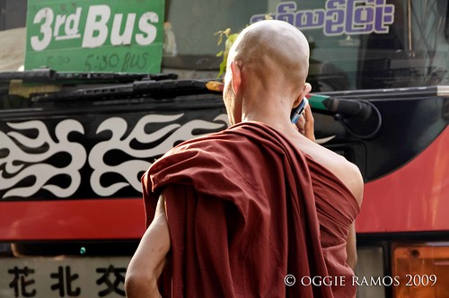 monk with a mobile phone