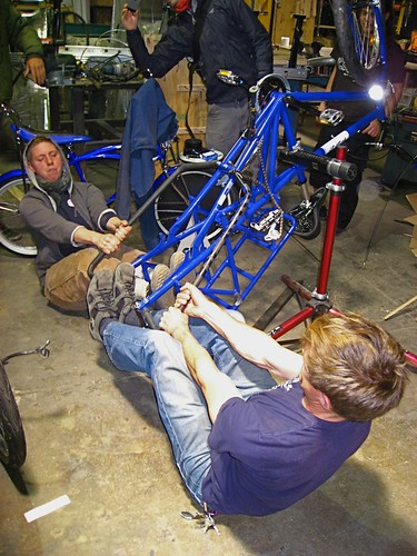 Leif and Emily stretching the Mundo frame to fit electric rear wheel.