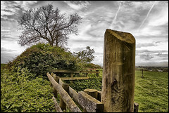 The Fence Post. (Pat Dalton...) Tags: wood sky cloud house tree water leaves canon fence geotagged bush gate branch contrail post sigma reservoir nettle 1770mm 450d saddington gumley takeitoutside theunforgettablepictures theunforgettablepicture betterthangood rubyphotographer pdeee454 leceistershire geo:lat=52500913 geo:lon=1016894