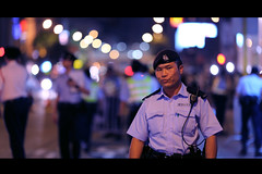 I have probably annoyed him (James Yeung) Tags: night hongkong hotel bokeh expression police cop streetphoto policeman annoyed wanchai swineflu ef135mmf2l bokehlicious canon5dmarkii