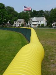 Outfield fence with flag