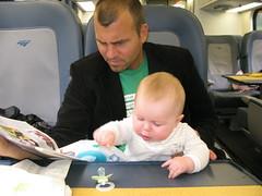 Hanalei and Dad reading on the Acela (Wayan Vota) Tags: train amtrak transit hanalei vota stockard foamer acel hanaleistockardvota