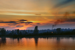 Sunset on Neva River (christian.senger) Tags: travel light sunset sky sun nature water silhouette yellow digital river geotagged outdoors fire gold nikon europe russia neva d300 whitenights nikoncapturenx2 christian_senger:year=2009