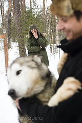 Husky keepers share a laugh, Lapland, Finland
