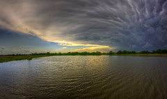 peacock storm reflection (davedehetre) Tags: sunset sky storm reflection weather landscape lawrence spring pond baker peacock fisheye wetlands kansas thunderstorm 8mm tornado hdr joplin meteorology severe mammatus photomatix mesocyclone samyang
