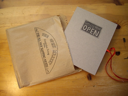 Open Market book and packet