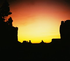 Monument Valley Sunset - Utah, USA (Batikart ... handicapped ... sorry for no comments) Tags: travel sunset red vacation arizona sky usa sun mountain black color tree rot nature berg weather silhouette yellow rock america landscape geotagged gold golden utah us spring ut holidays glow colours sonnenuntergang sundown urlaub natur himmel f100 olympus scan formation gelb 1992 geology navajo monumentvalley amerika landschaft 2009 baum schwarz vacanze frhling tafelberg southwestusa rockformation scherenschnitt geologie supershot 100faves 50faves 200faves olympusslr abigfave viewonblack anawesomeshot theunforgettablepictures batikart sdwestenusa 201202