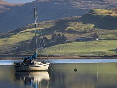 Skye Boat Song (tricycledteenager) Tags: reflection skye scotland boat scene calm talisker carbost lochharport highlandsandislands themistyisle