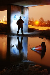 Take time to reflect (AndWhyNot) Tags: bridge light shadow portrait people colour reflection water silhouette night portraits painting puddle concrete person long exposure traffic motorway cone pillar overcast andrew cast pollution ripples whyte 1181 andwhynot sigma2460f28ex