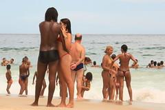 Couple embracing at Copacabana beach (Ricardo Carreon) Tags: girls brazil people woman man praia beach topf25 girl rio brasil riodejaneiro topv2222 pessoas women couple rj gente pareja playa copacabana bikini thong gstring mulheres swimsuit casal topv666 mujeres homem bathingsuit hombre plague biquini swimware top3333