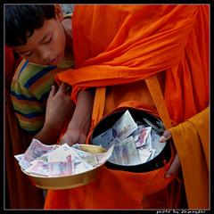 (zhengzhi) Tags: boy money cambodia monk bayou siemreap riel