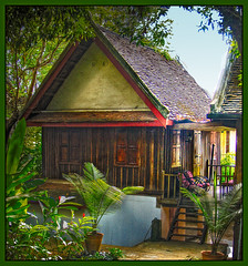 House in Luang Prabang, Laos (Anguskirk) Tags: trees plants house building architecture wooden little small cottage laos quaint stilts luangprabang piles indochina venacular