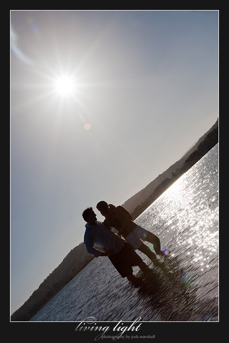 Sun flare and couple in water. Engagement session at Speers Point, Lake Macquarie, Newcastle.