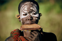 Africa - Ethiopia / Surma woman (RURO photography) Tags: voyage africa travel portrait tourism beautiful smile face female canon photography mujer pretty faces photos retrato african femme mulher cara reis tribal tourist bodypaint portraiture tribes afrika lip earrings portret anthropology scarification stam reizen ethnology omo thiopien etiopia stammen gesichter halsketting tribus omorate ethnie kartpostal fun lipplate tribalgroup enstantane oorringen  etiyopya anawesomeshot journalistchronicles   supershot ethnograaf ethnografisch vanishingculture oorschijfjes globalbackpackers lonelyplanet discoveryphoto discoverychannel discoveryexpeditions voyageursdumonde nationalgeographic inspiredelite rudiroels thegalleryoffineportrait athiopien lipschijf