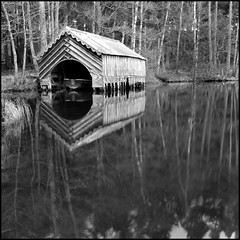 Dhu Loch Boathouse (angus clyne) Tags: old trees house reflection water scotland boat blackwhite spring decay perthshire loch dunkeld boathouse soe birnam flikcr dhu platinumphoto dhuloch