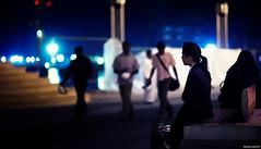 Letters Never Sent | 112.365 (Stephan Geyer) Tags: street blue woman girl night canon lowlight dubai shadows dof bokeh availablelight candid silhouettes 85mm 5d canon5d 365 burjdubai canoneos5d project365 8512 85l ef85mmf12lusm dubaimall soukalbahar canoneos5dclassic