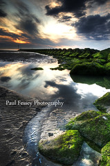 Only you see the sun set on amphetamines. (Paul Fessey) Tags: new sunset reflection green beach water paul photography sand nikon rocks brighton shell d300 fessey reallystunk