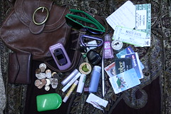 A look inside. (inconsequential!) Tags: sunglasses trash pen keys wallet id cellphone ticket purse change lipgloss librarycard creditcards inhaler sparechange handcream grocerylist cuticlecream lipstain retainercase barnesnoblemembership