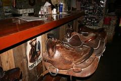 Saddle up and have a drink (faronspix) Tags: blue arizona bar canon rebel desert barstools saloon saddles daytrip tortillaflats