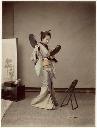 Japanese woman with mirrors by George Eastman House