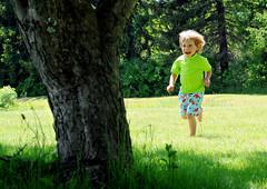 Happiness (noamgalai) Tags: tree green nature smile happy photo kid picture running run blond photograph greenshirt    noamg noamgalai