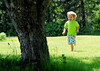 Happiness (noamgalai) Tags: tree green nature smile happy photo kid picture running run blond photograph greenshirt צילום תמונה נועם noamg noamgalai נועםגלאי גלאי