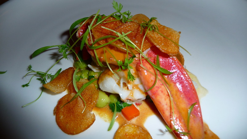 Butter poached lobster with potato chips, edamame, carrots and horseradish jus at JLOB
