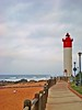 Umhlanga Lighthouse, Durban (A guy called John) Tags: africa sea brown lighthouse beach water southafrica hotel golden interestingness sand rocks waves path south wave playa explore walkway sands seashore goldenbrown durban umhlangarocks umhlanga zuidafrika suidafrika explored umshlanga pfogold umshlangarocks umhlangarockslighthouse umshlangarockslighthouse