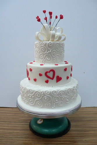 White wedding Cake with hearts and swirls