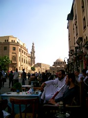 Cairo: As the world goes by... (Stationary Nomads) Tags: life street men cafe shisha mosque cairo dome egyptian minarets hookah oldcairo alazhar khanelkhalili islamiccairo masr egyptianmen alazharmosque alqahira shishacafe