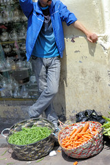 Headless Carrot Moroccan Man (cwgoodroe) Tags: ocean africa street old city sea summer people sun fish bus colors metal ferry plane children cafe sand ancient colorful doors artistic pentax vibrant muslim poor streetlife mosque arabic panasonic doorway morocco arab friendly moors conservative script casbah vegtable merchants continent merchant christians tangier monger moroccan tanger kasbah cleric sadfaces metaldoors fishmerchant casba casbha dailylifeportrait