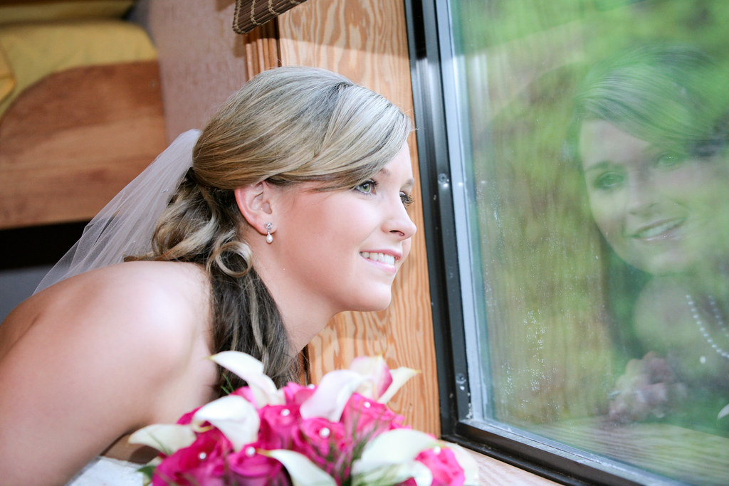reflection as the bride watches her guests arrive