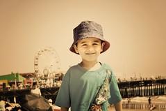 My son at the pier (voo_doolady) Tags: boy portrait wheel photoshop vintage children pier kid child cs2 son ferris santamonicabeach actions florabella