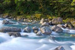 Foamy flow (neilcreek) Tags: longexposure newzealand water rock river scenery rocks riverside rapids foam southisland environment milford freshwater horizontalorientation