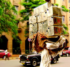 Ah my burden so heavy (KittyKaht) Tags: brown white man stone town colours taxi mumbai load mycity rbi