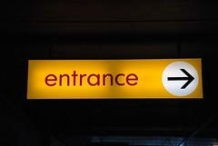 This Way... (JonnyBaird) Tags: sign entrance illuminated redtext rightarrow 2009yip