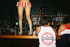 * (matt_robinson) Tags: bali woman colour beer bar america indonesia stars fuji superia stripes flash super dancer 200 jalan redwhiteandblue yashica bintang t4 doublesix