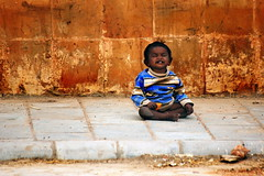 Orange Smile (Gilad Benari) Tags: street city portrait urban orange baby india cute art texture smile wall print poster fun gold kid different pavement streetphotography newdelhi orangesmile orangewall        giladbenari indianbaby    picturesofindia    indainkid