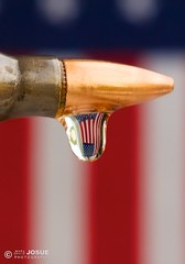 Honoring the Fallen (mj.foto) Tags: usa macro america army nikon memorial unitedstates flag wwii navy worldwarii american micro hero ww2 droplet marines bullet heroes airforce nikkor veteran memorialday worldwar2 starspangledbanner 223 105mm 105mmf28gvrmicro unitedstatesarmedforces 556x45 d700 nikkor105mmf28gvrmicro m855 ss109 m193