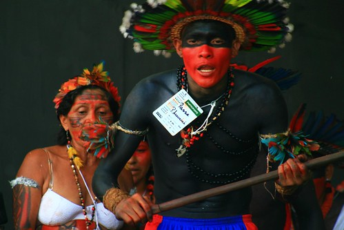 Indigenous performers replace the session on climate change. Probably to the delight of the crowd.