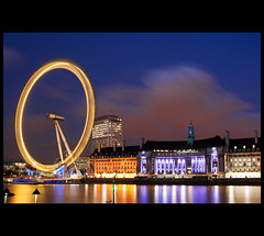 The Eye Beholds: Dusk (Nrbelex) Tags: city longexposure blue sky bw london eye water wheel thames museum night canon river 2470mml europe glow sundown shoreline londoneye southbank explore shore ferriswheel bluehour dslr cp polarizer riverthames thamesriver circularpolarizer londonist 2470mm 2470mmf28 explore1 xti ef2470mm 400d bwcircularpolarizer nrbelex