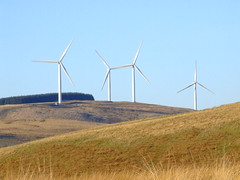 WINDFARM, in the big blue sky. (the water watcher 05.) Tags: wood blue trees winter sky white tree green nature skyline rural forest landscape scotland countryside woods frost december skies view hill bluesky farmland hills moors blueskies wintertime moor turbine borders hilltop windturbine windfarm moorland steephill dumfriesandgalloway sedge countryscene dumfriesshire langholm ruralscene fujifinepixs5600 midhill timpen langholmwalks timpenhill dumfriesshirehills