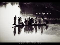 The Ferry (Shabbir Ferdous) Tags: portrait people blackandwhite bw reflection nature water monochrome ferry landscape boat photographer shot tone sylhet bangladesh bangladeshi srimangal canoneos5d quadtones ef70200mmf28lisusm shabbirferdous wwwshabbirferdouscom shabbirferdouscom